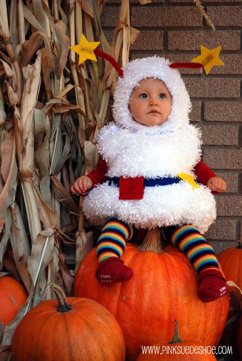 Twink sitting on pumpkin